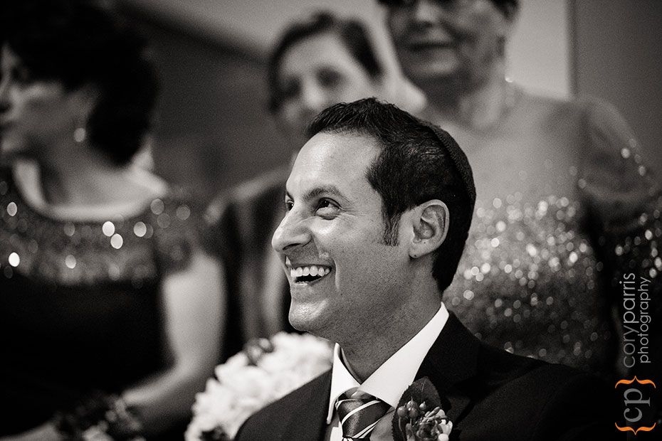 groom laughing during ketubah signing