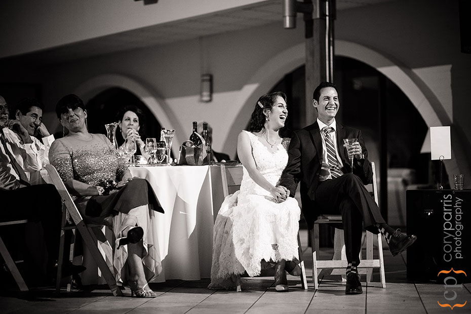 wedding couple laughing at toasts