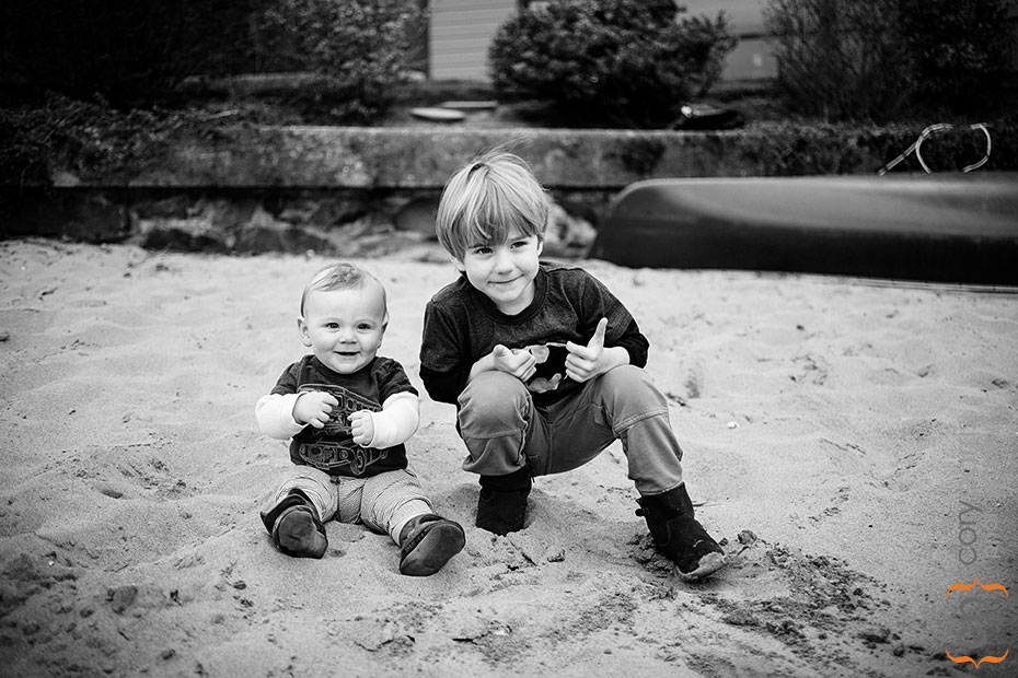 two little boys in the sand