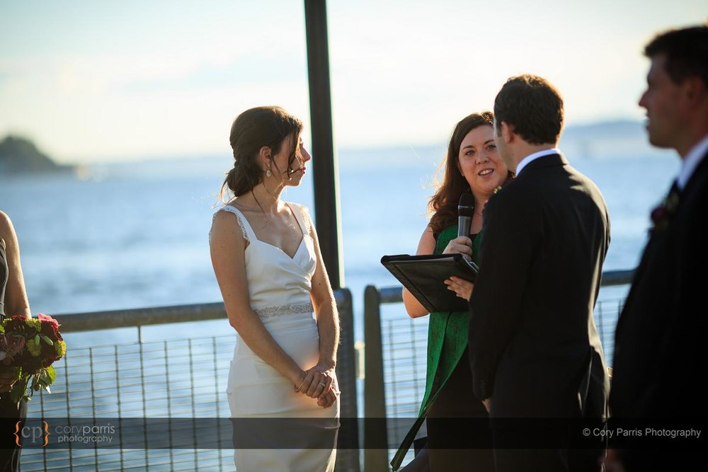 Getting married on the pier behind the Seattle Aquarium.