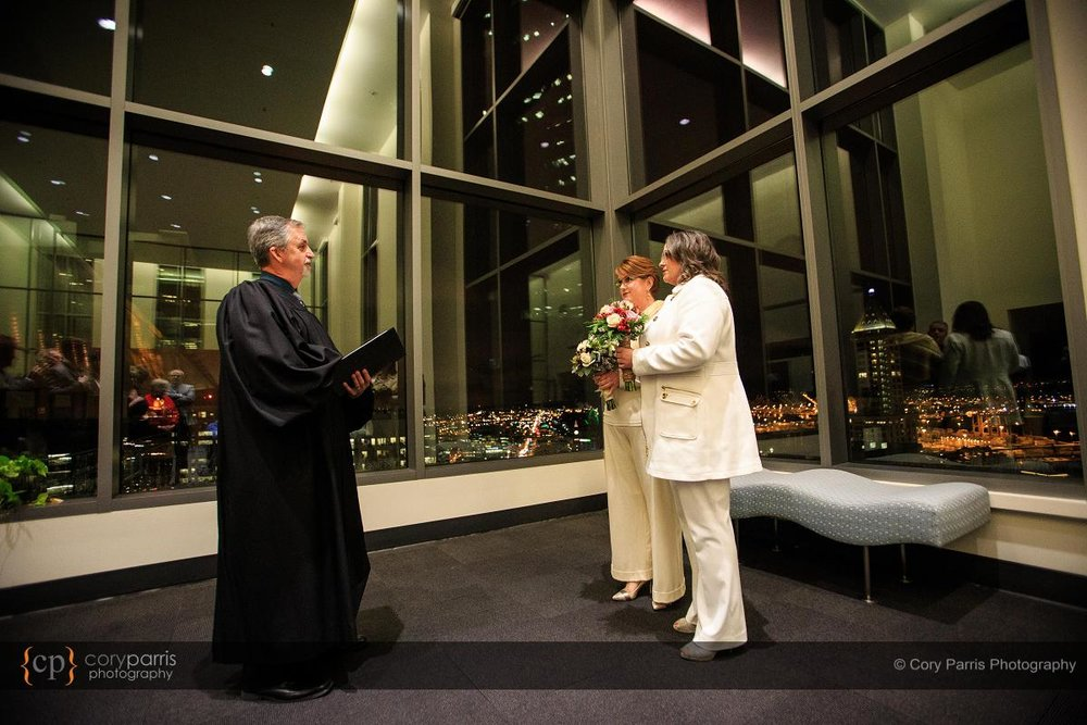 wedding ceremony with the city lights in the background.
