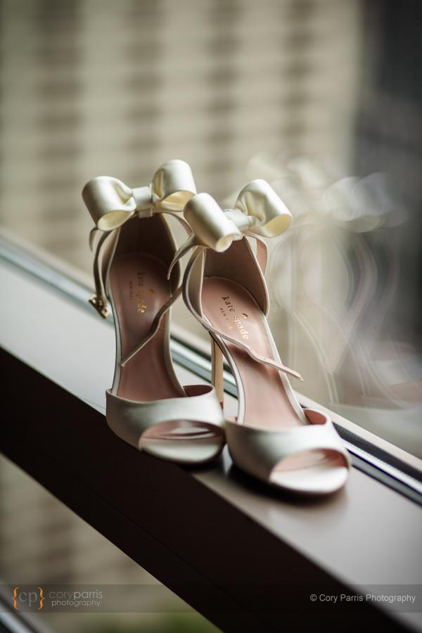Very cool wedding shoes with the bows on the back.
