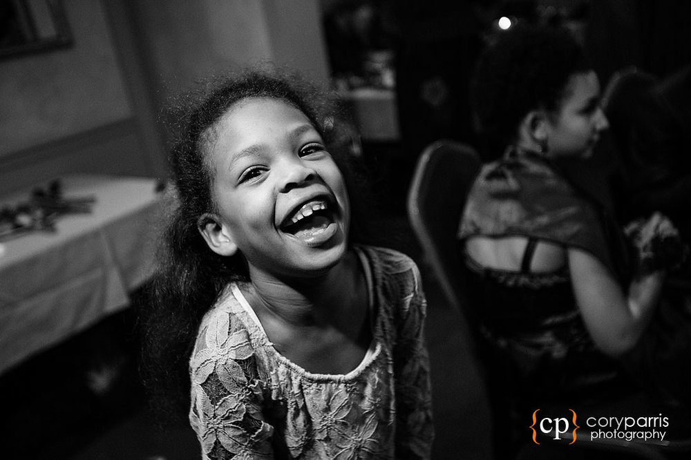 Kid laughing at a wedding reception