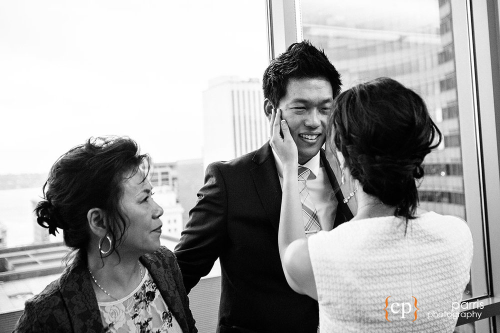 Bride wiping tears from groom's face