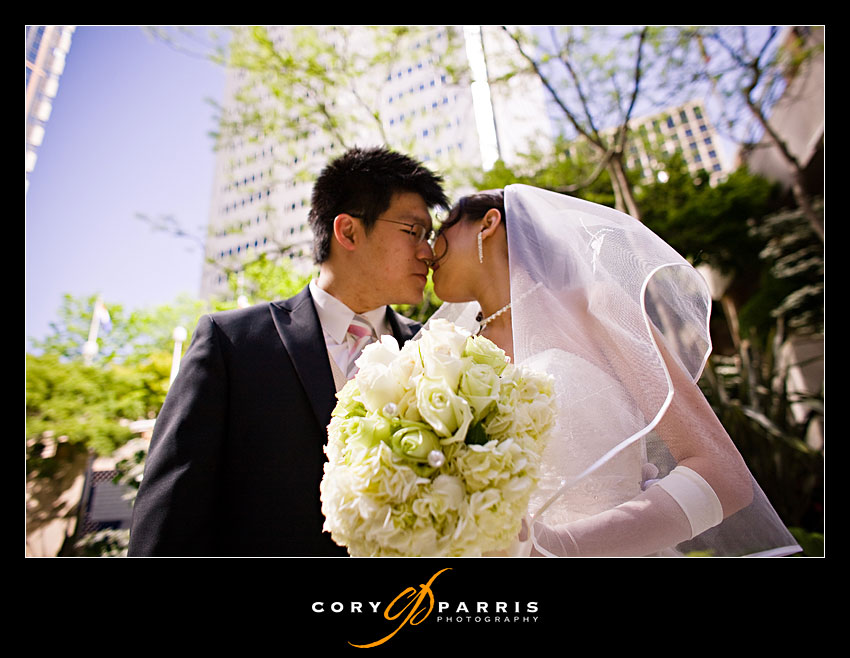 bride and groom kissing at two union square