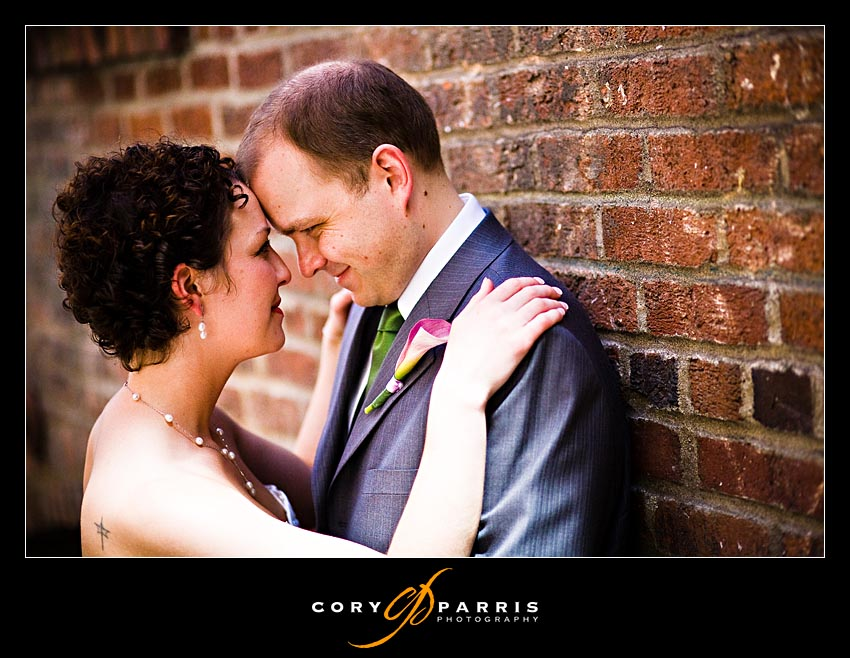 Wedding couple on the brick wall in post alley