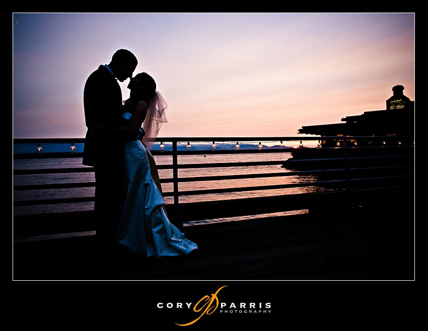 sunset bride and groom at rays boathouse in seattle