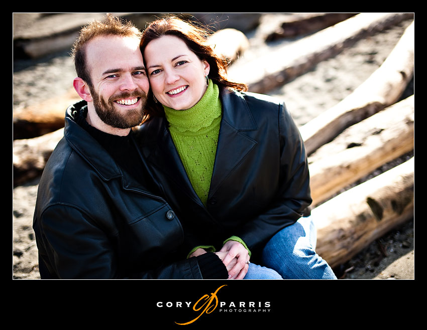 Couple on the cold, sunny mukilteo beach