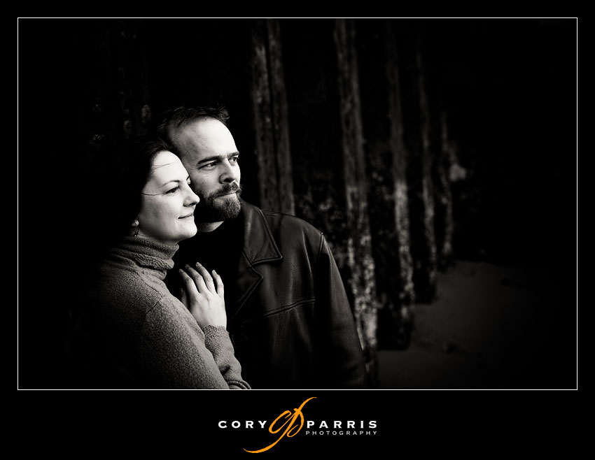 moody couple portrait by the seawall
