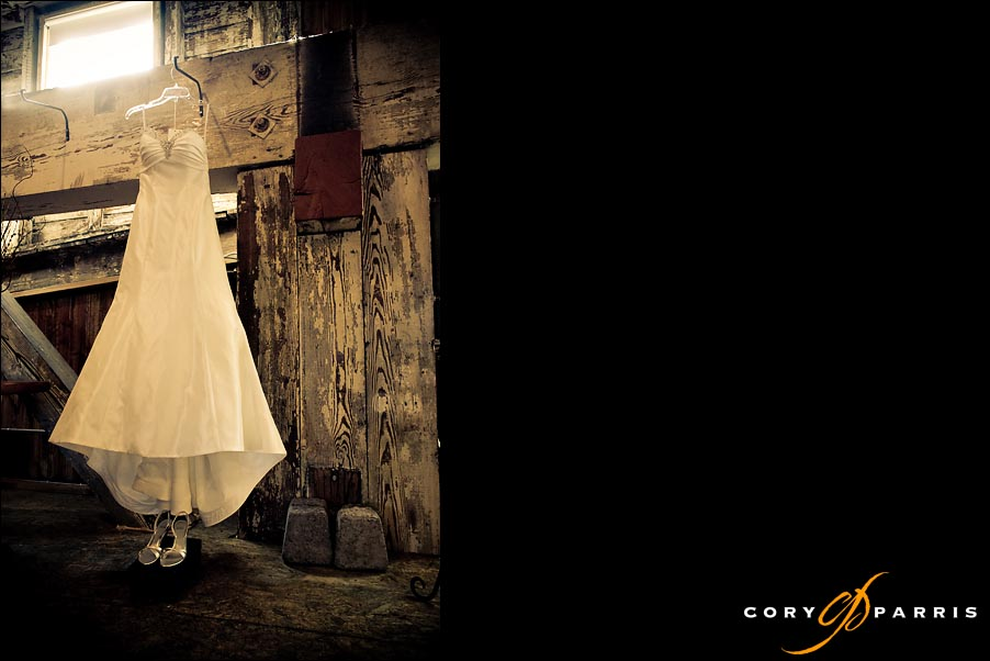 wedding dress hanging in a warehouse by seattle wedding photographer cory parris