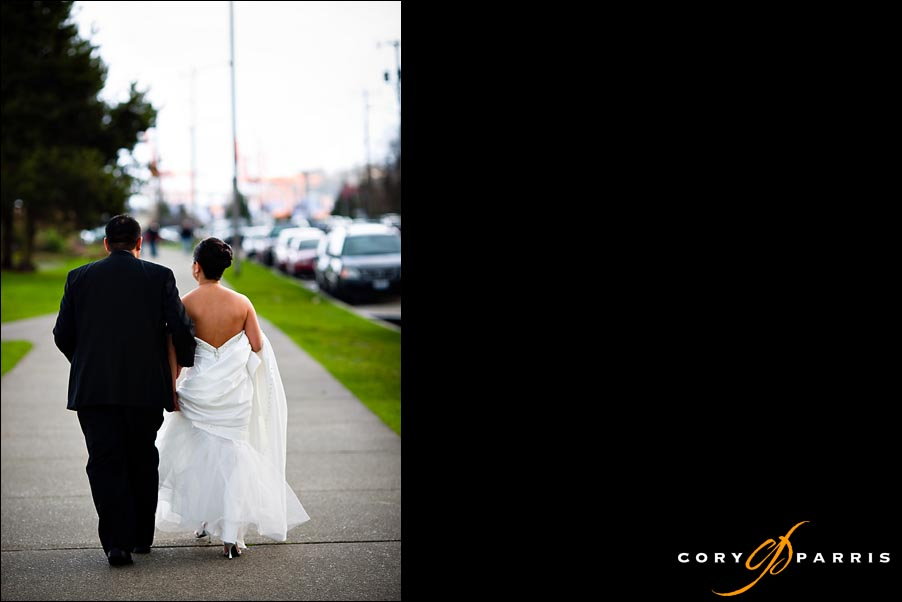 bride and groom walking together by seattle wedding photographer cory parris