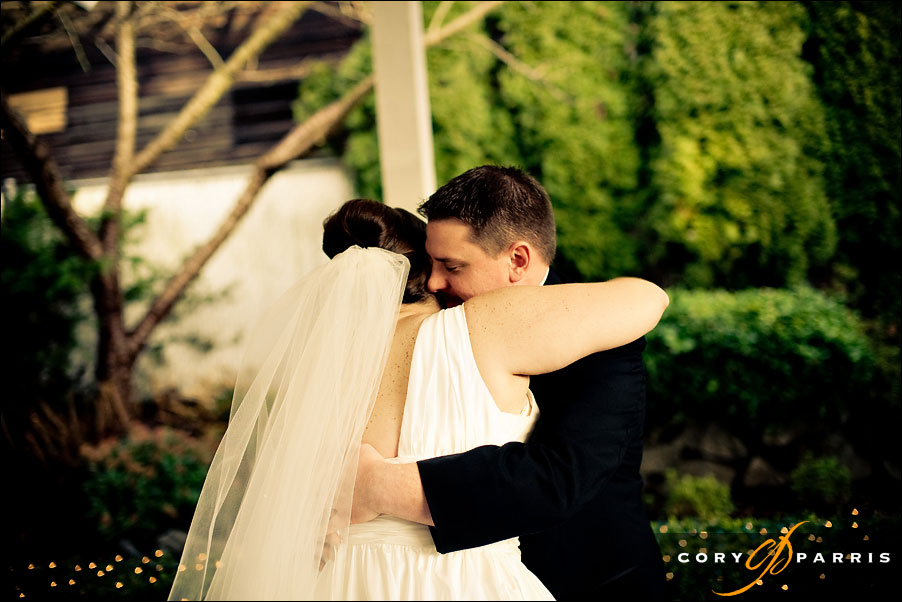 bride and groom hugging as they have their first glance, first sight