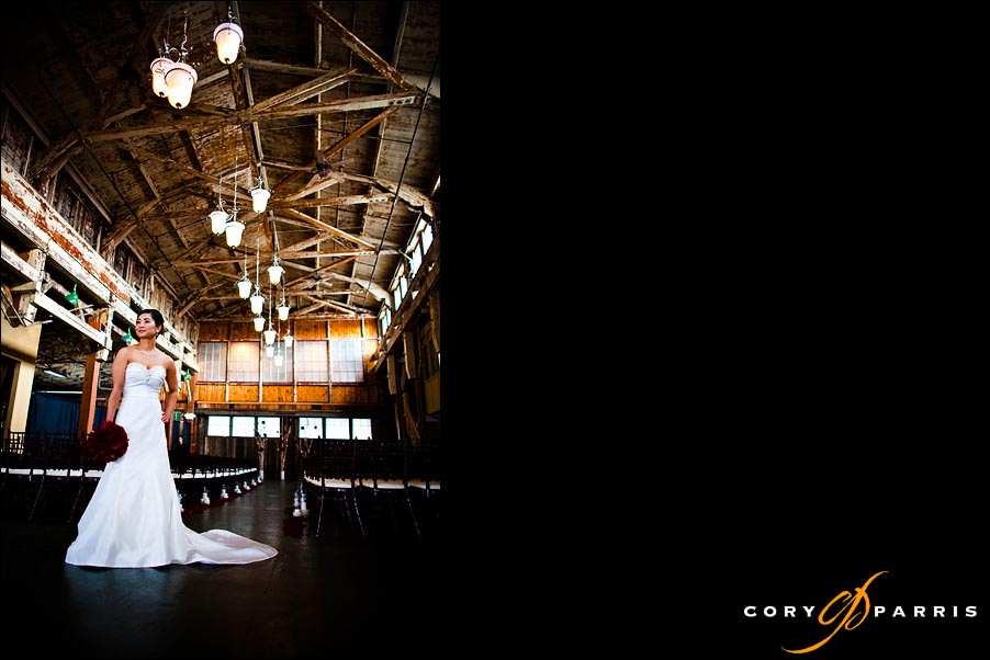 bride standing in the old warehouse feel of SODO Park in Seattle by photographer cory parris