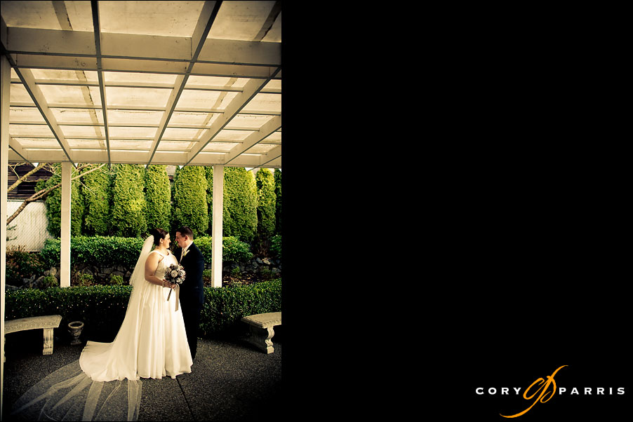 bride and groom together on the back patio at the Antheia Ballroom in Snohomish