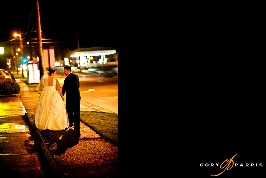 bride and groom walking down the street at night in snohomish