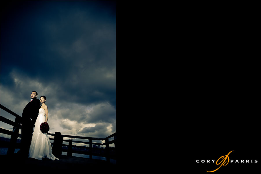 wedding photograph of a couple on the seattle waterfront by seattle wedding photographer cory parris