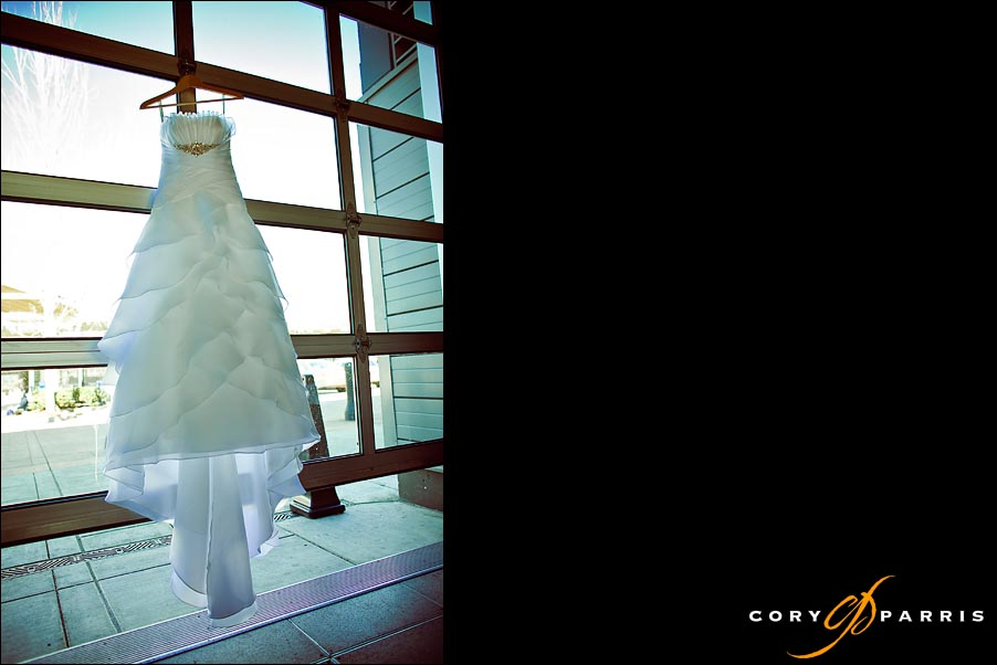 wedding dress hanging from glass garage door
