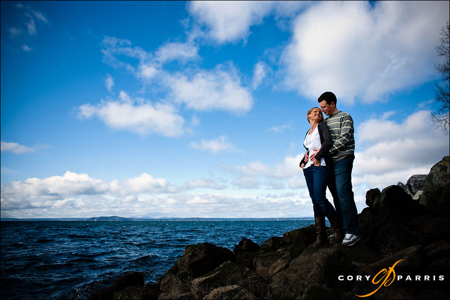 couple on the rocks on the seattle waterfront by seattle portrait photographer cory parris