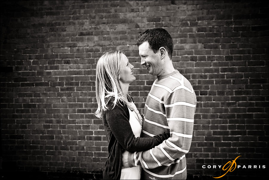couple portrait with brick wall in b&w by seattle wedding photographer cory parris