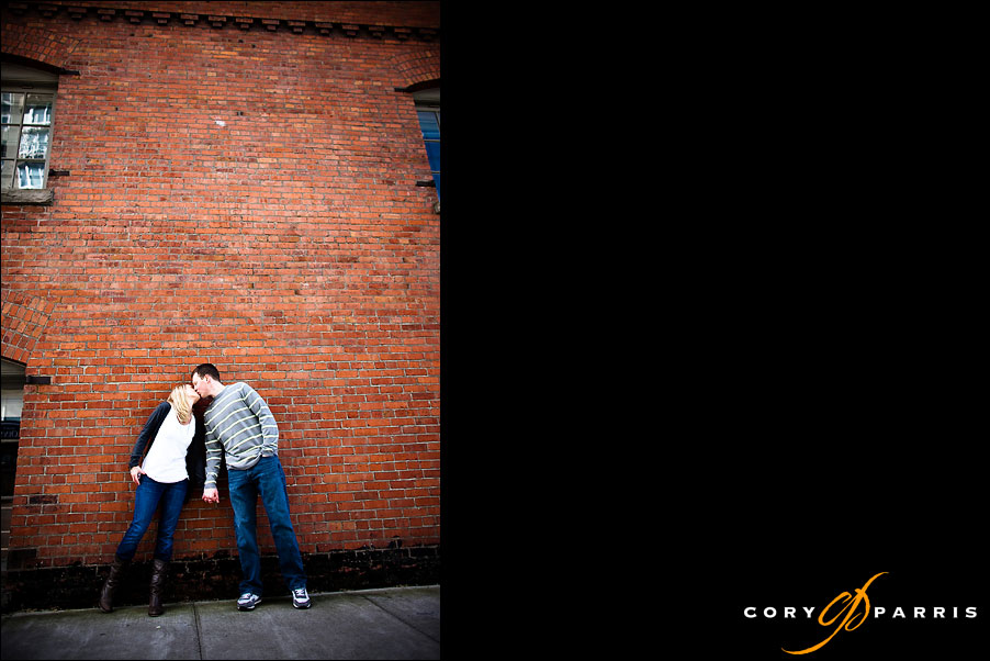 couple portrait by brick wall by seattle wedding photographer cory parris