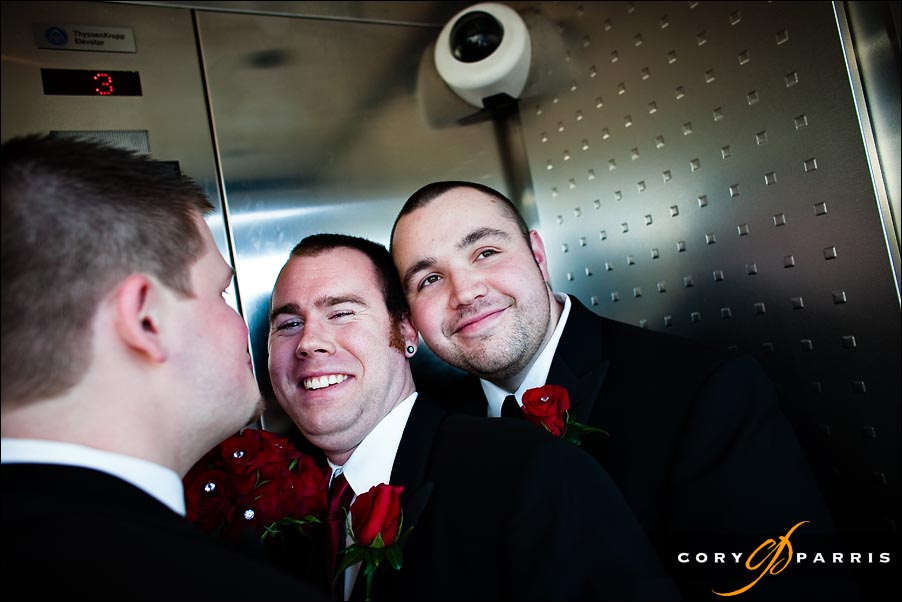groom and groomsmen messing around in the elevator