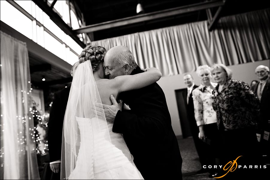 bride and her father hugging during the wedding