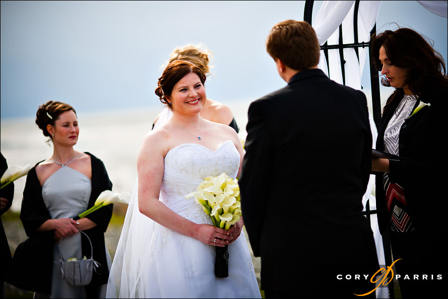 bride smiling at groom during the wedding ceremony by seattle wedding photographer cory parris