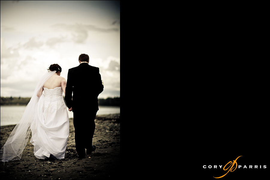 wedding couple walking together on the beach at Semiahmoo