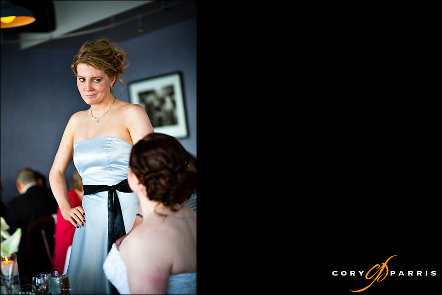 bridesmaid talking with the bride by seattle wedding photojournalist cory parris