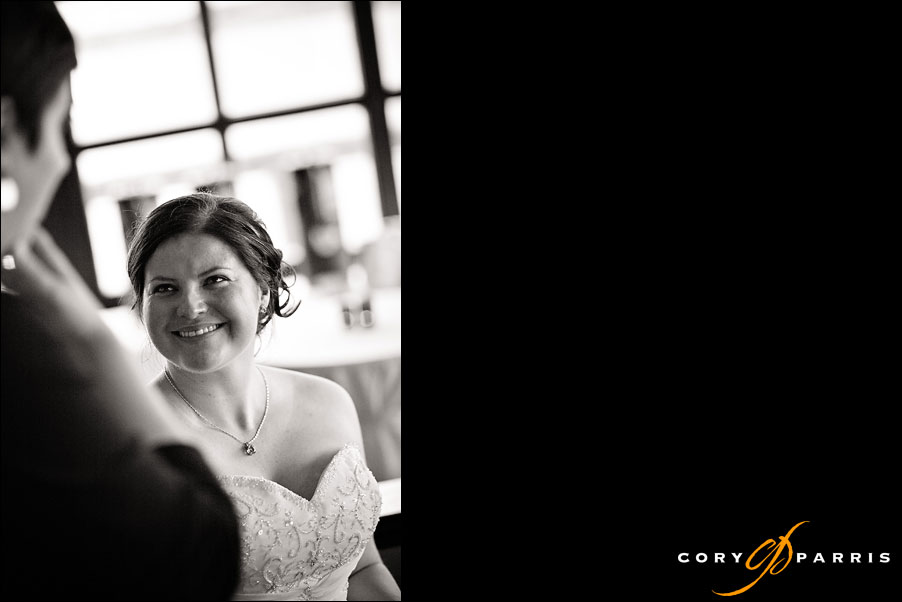 bride talking to a guest at the wedding by seattle wedding photojournalist cory parris