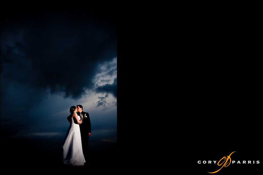 bride and groom dramatic portrait on the beach at semiahmoo by seatle wedding photographer cory parris