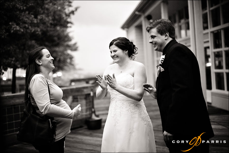 happy bride talking to a wedding guest