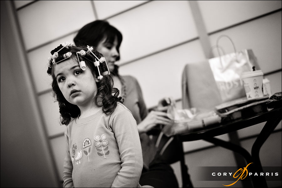 little girl with curlers in her hair before the wedding by seattle photojournalist cory parris