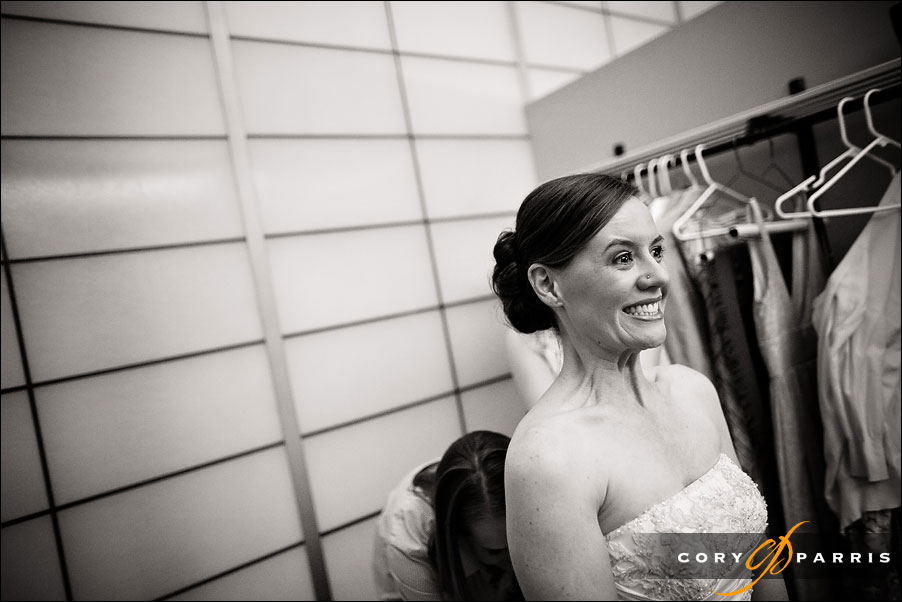 excited bride getting ready for the wedding by seattle wedding photojournalist cory parris