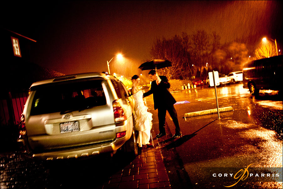 bride and groom escaping to the pouring rain at the end of their wedding at pickering barn