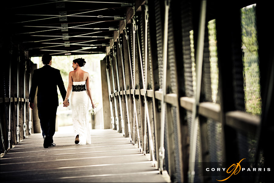 couple walking across a bridge.  seattle wedding photography by cory parris