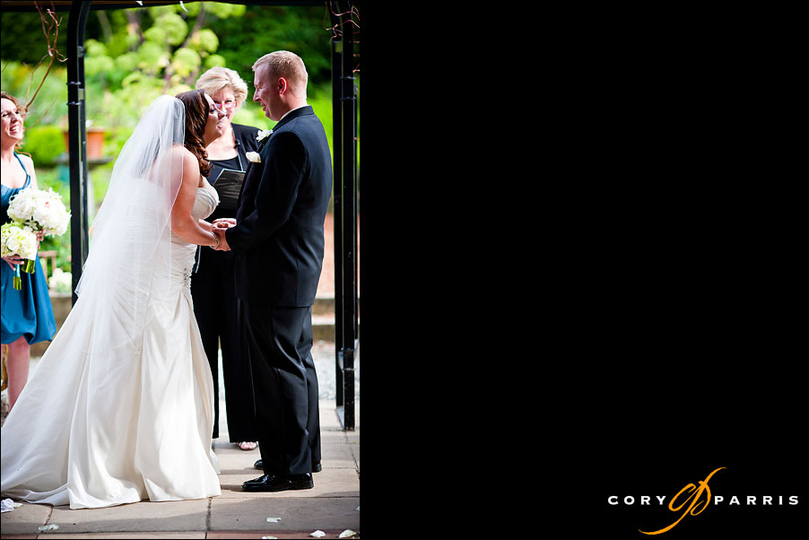 bride and groom laughing during wedding ceremony by seattle wedding photographer cory parris