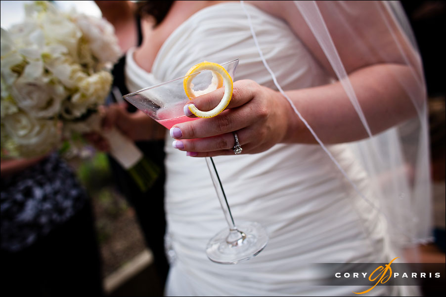 bride holding a cocktail by seattle wedding photojournalist cory parris
