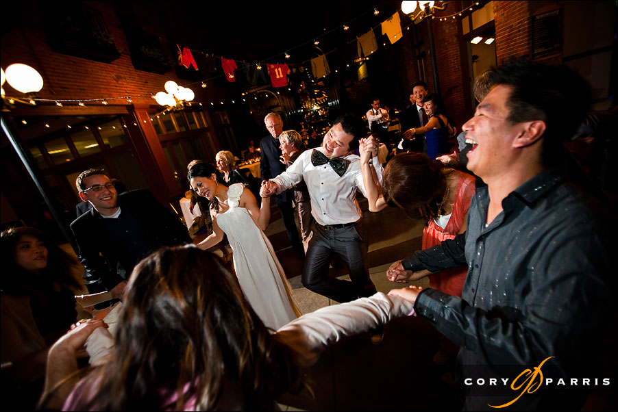 bride and groom dancing at reception by seattle wedding photographer cory parris