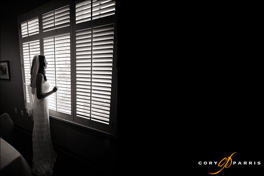 bride looking out the window at the rain at newcastle golf club