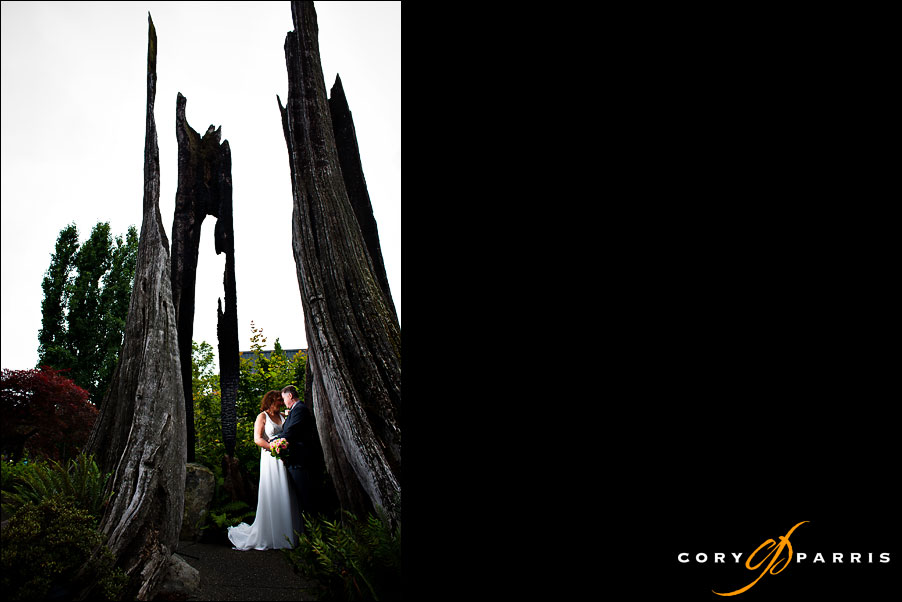 wedding couple portrait in the burnt out tree in front of willows lodge in woodinville