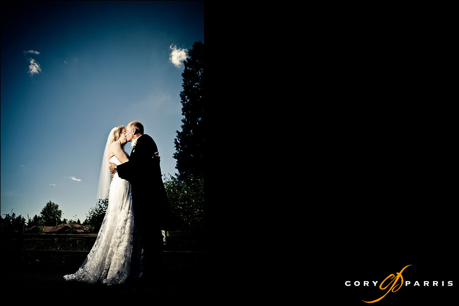 bride and groom kissing - seattle wedding photographer cory parris uses strobist flash techniques