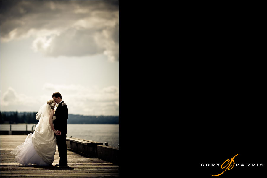 bride and groom lake washington dock at woodmark hotel by seattle wedding photographer cory parris