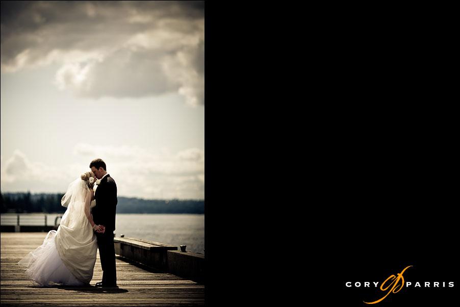 bride and groom lake washington dock at woodmark hotel by seattle wedding photographer cory parris