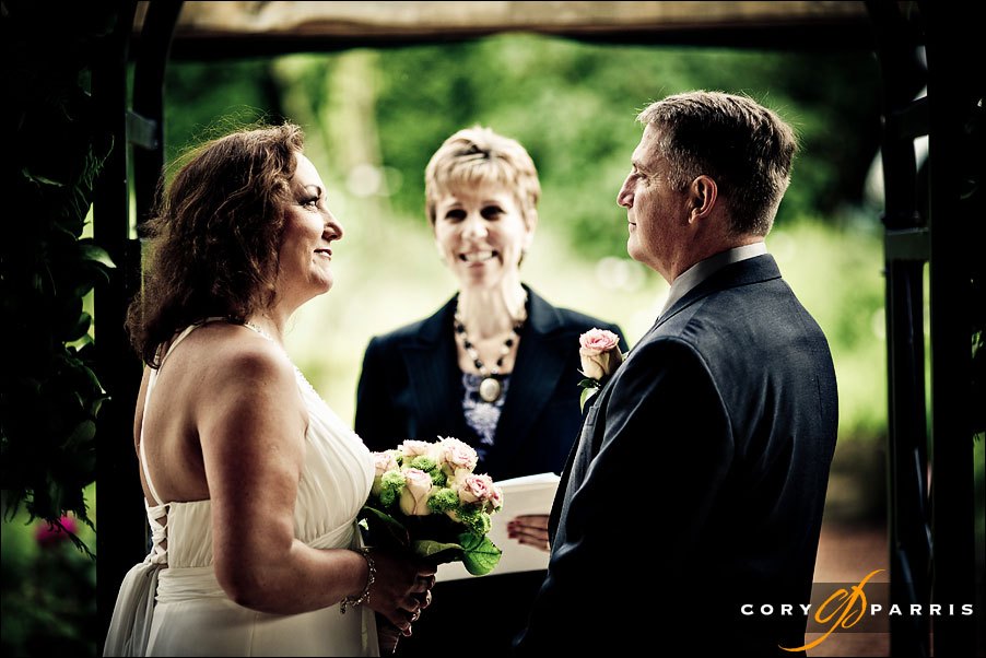 bride, groom and annemarie juhlian the wedding officiant at willows lodge during the wedding ceremony