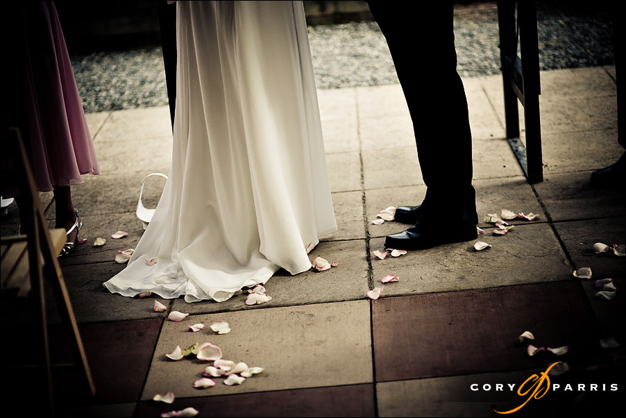 feet during the wedding ceremony at willows lodge by seattle wedding photographer cory parris