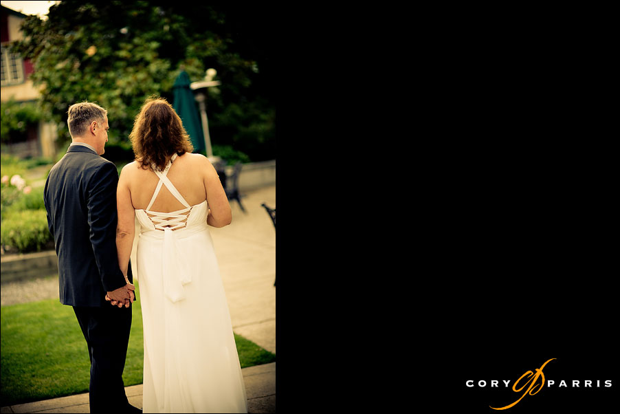 wedding couple walking away after ceremony at willows lodge