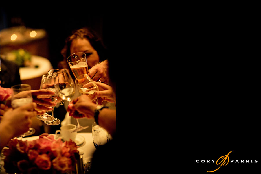 toasting glasses by seattle wedding photojournalist cory parris