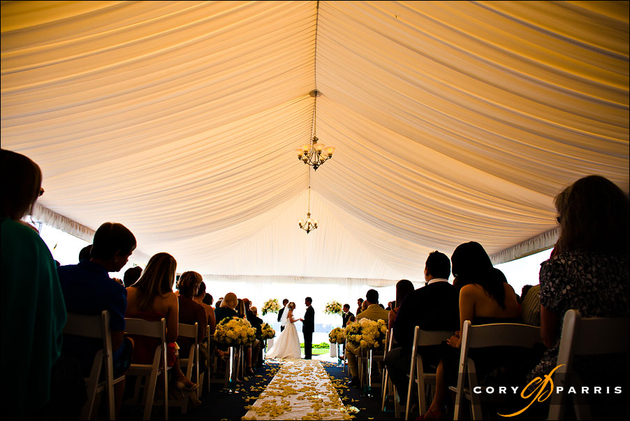 wedding ceremony inside the tent at the woodmark hotel on lake washington by seattle wedding photojournalist cory parris