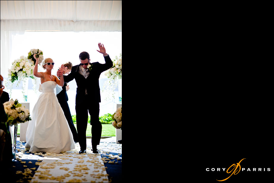bridal couple dancing down the aisle by seattle wedding photojournalist cory parris
